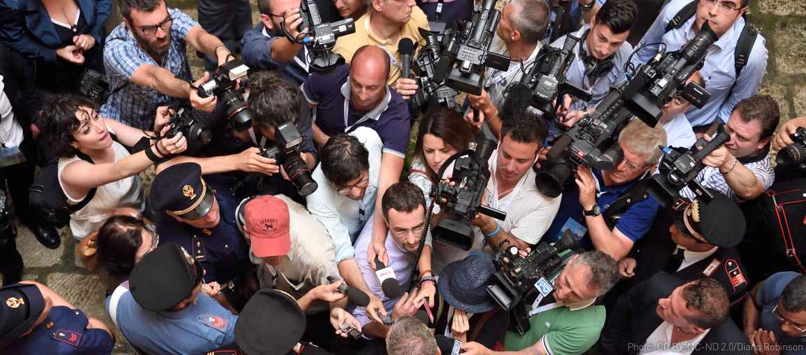 overhead shot of group of reporters